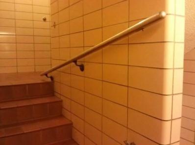 La rampe d'escalier rapetissante