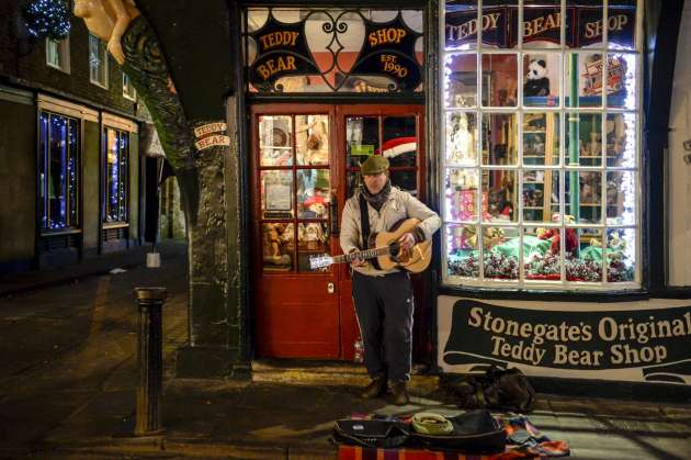yorkshire-Strumming on the streets of York. Andrew Testa for The New York Time